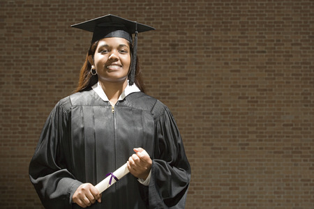 jamaican adult: Female graduate holding her diploma Stock Photo