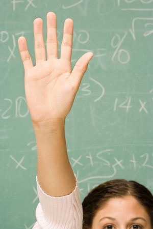primary school: Female student with her hand raised