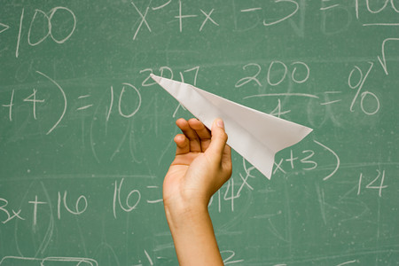 throw paper: Student about to throw paper aeroplane