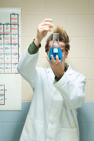 spiked hair: Male student performing an experiment