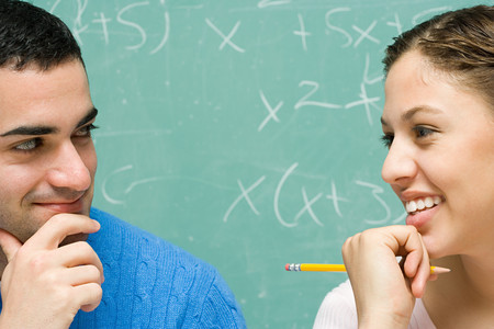 misbehaving: Two students flirting Stock Photo