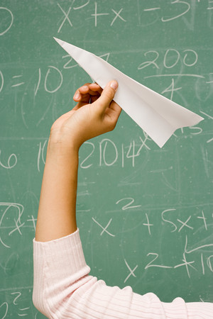 throw paper: Student about to throw a paper aeroplane