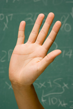 higher intelligence: Student with hand raised