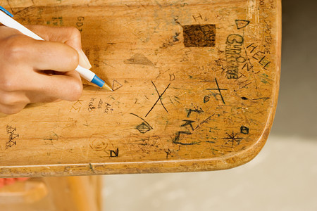 misbehaving: Student drawing on desk