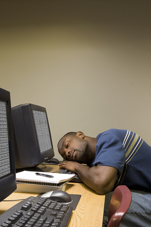 final examination: Male student sleeping at his computer Stock Photo