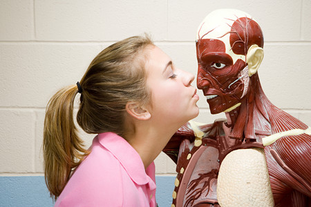 anatomical model: Female student kissing an anatomical model