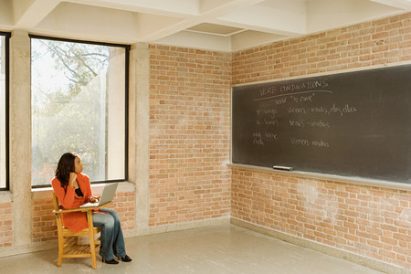 lecture theatre: Female student sat working alone Stock Photo