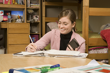 Female student studying in her dormitory Stock Photo
