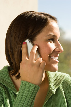 cellular telephone: Female student talking on her cellular telephone