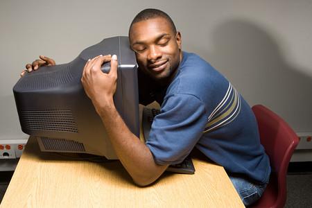 black man: Male student sleeping on his computer Stock Photo