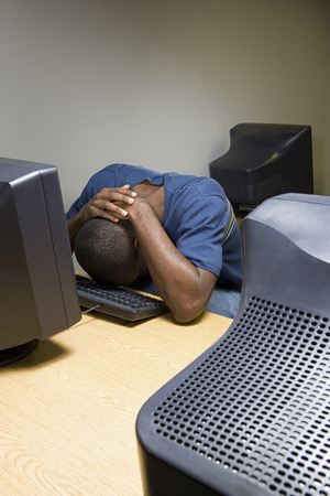 american downloads: Male student sleeping at his computer Stock Photo