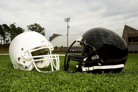 bowl game: Black and white football helmets Stock Photo