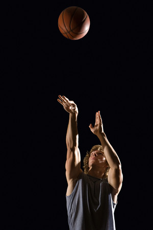 black person: Man throwing basketball Stock Photo