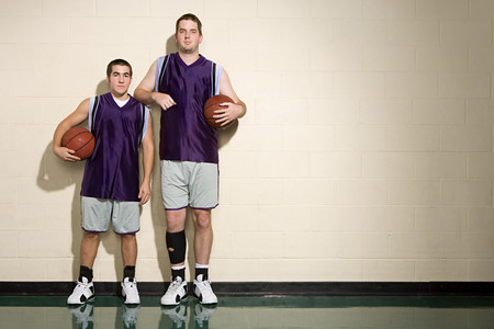 Tall and short basketball players Stock fotó - 49849564