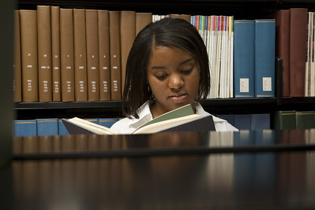 junior education: Female student reading in the library