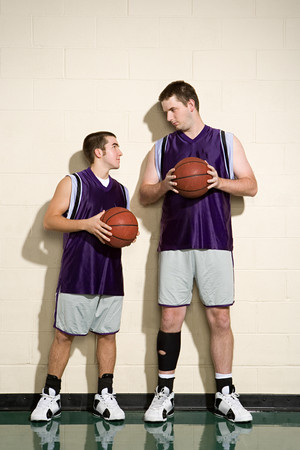 comparable: Tall and short basketball players