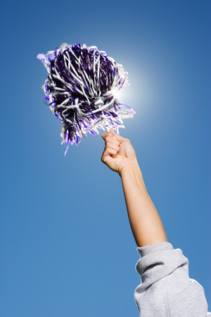 pompom: Arm of a cheerleader holding pom-pom Stock Photo