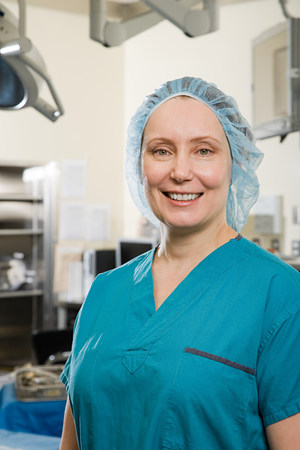operating theatre: Surgeon in operating theatre Stock Photo