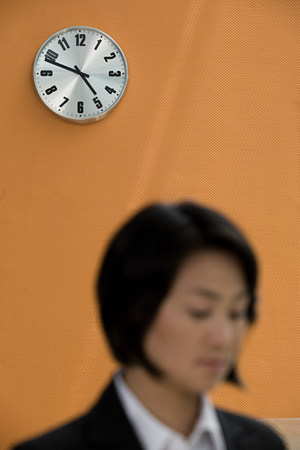Wall clock and a businesswoman
