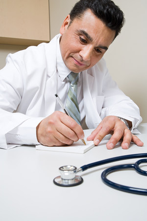 doctor writing: Doctor writing prescription