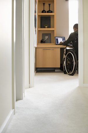 overcoming adversity: Disabled man telecommuting Stock Photo