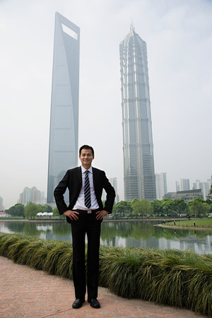 jin mao tower: Chinese businessman near skyscrapers Stock Photo