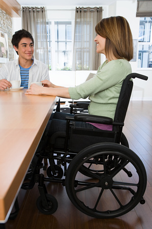 16 17 years: Disabled mother with son Stock Photo