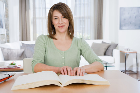 braille: Blind woman reading braille