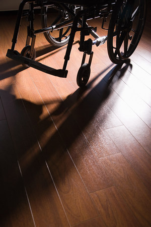 disability insurance: Wheelchair on a wooden floor