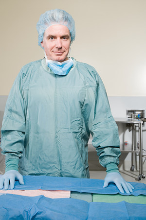 surgical scrubs: Surgeon in operating theatre Stock Photo