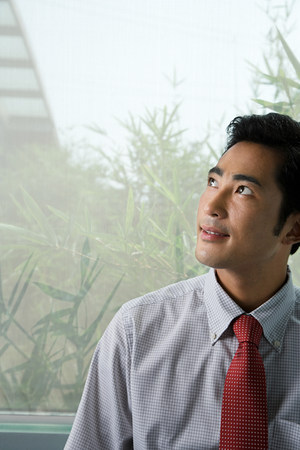 businessman thinking: young Chinese businessman