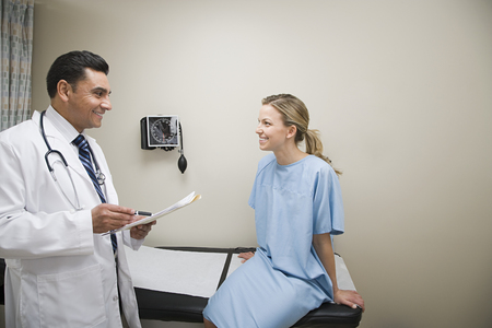 40 44 years: Doctor and patient Stock Photo