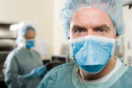surgeon mask: Surgeons in operating theatre Stock Photo
