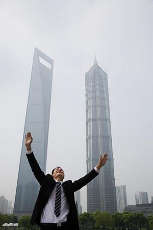 joyous: Joyous businessman with his arms raised Stock Photo