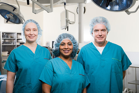 operating theatre: Surgeons in operating theatre Stock Photo