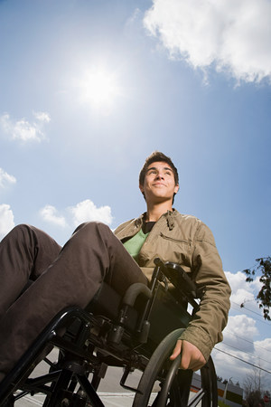 16 17 years: Low angle view of a disabled teenage boy Stock Photo