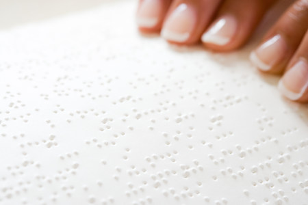 capable of learning: Woman reading braille