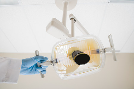 in ceiling: Dentist with lamp