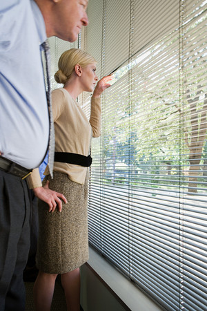 looking out: Colleagues looking out of window