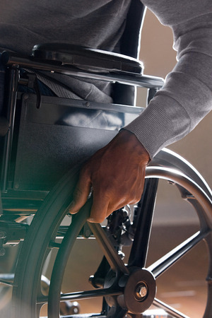 overcoming adversity: Man using a wheelchair