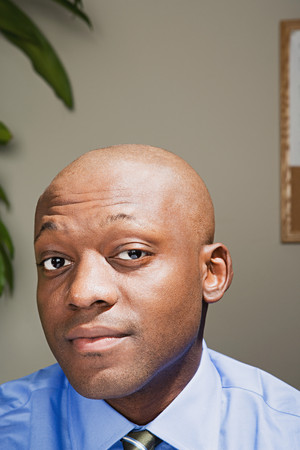 raised eyebrow: Businessman looking confident