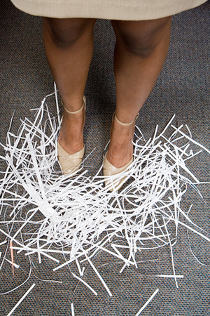 shredded paper: Woman with shredded paper at her feet