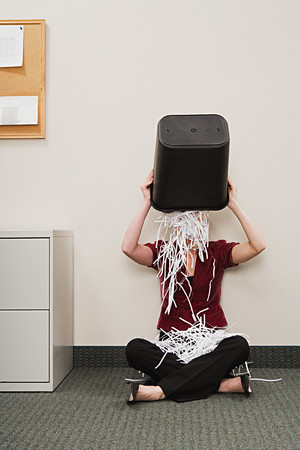 shredded paper: Woman tipping shredded paper over herself Stock Photo