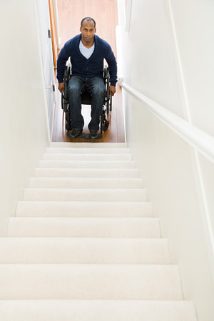 trapped: Disabled man trapped at bottom of stairs