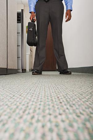 stood: Businessman stood in corridor
