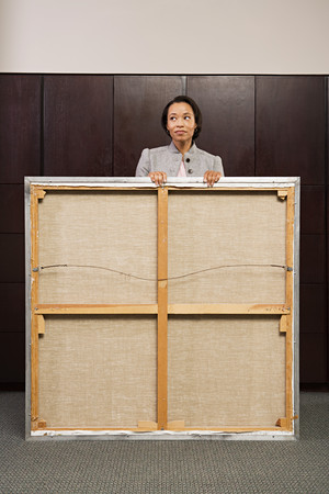 arduous: Business woman carrying canvas