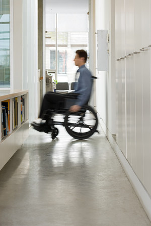 equal opportunity: Blurred man in a wheelchair