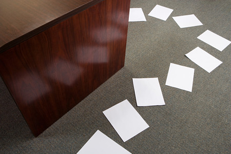 individually: Paper on office floor Stock Photo