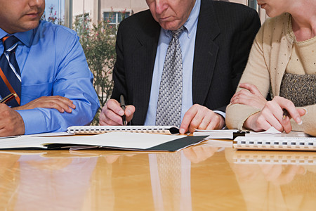 individually: Businesspeople working together Stock Photo