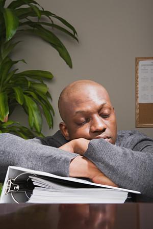 one mid adult man: Businessman sleeping at work Stock Photo